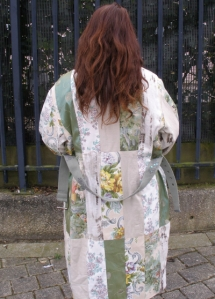 Classical coat or dressing gown in floral creams with a little shiny green