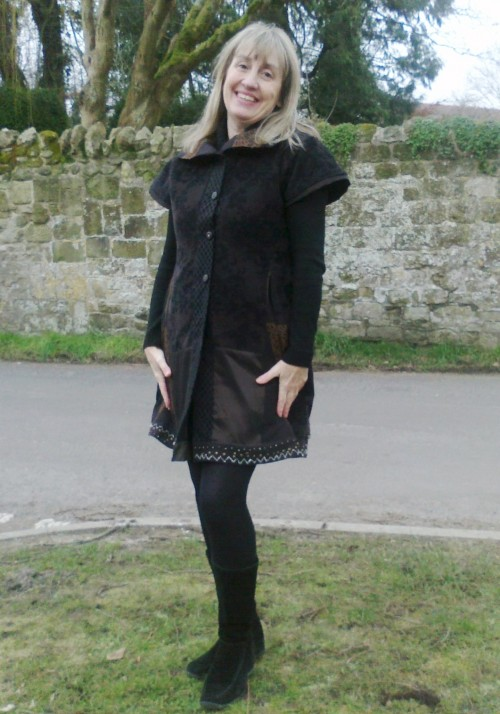 Brown,black jerkin dress with metal beaded hem