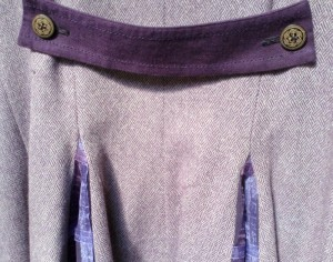 Purple coat dress back tab.