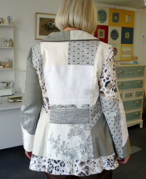 Cream, grey jacket, back model s