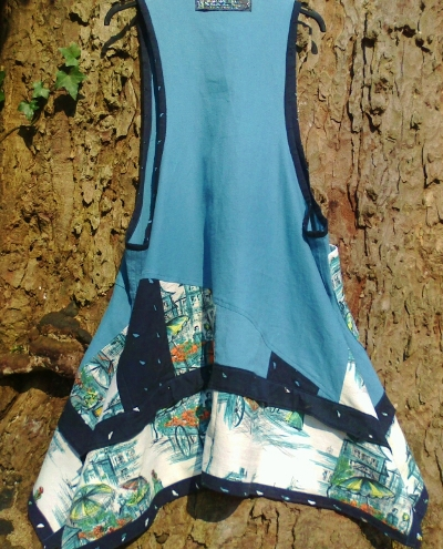 Pinafore dress, blue, black, back view on tree s