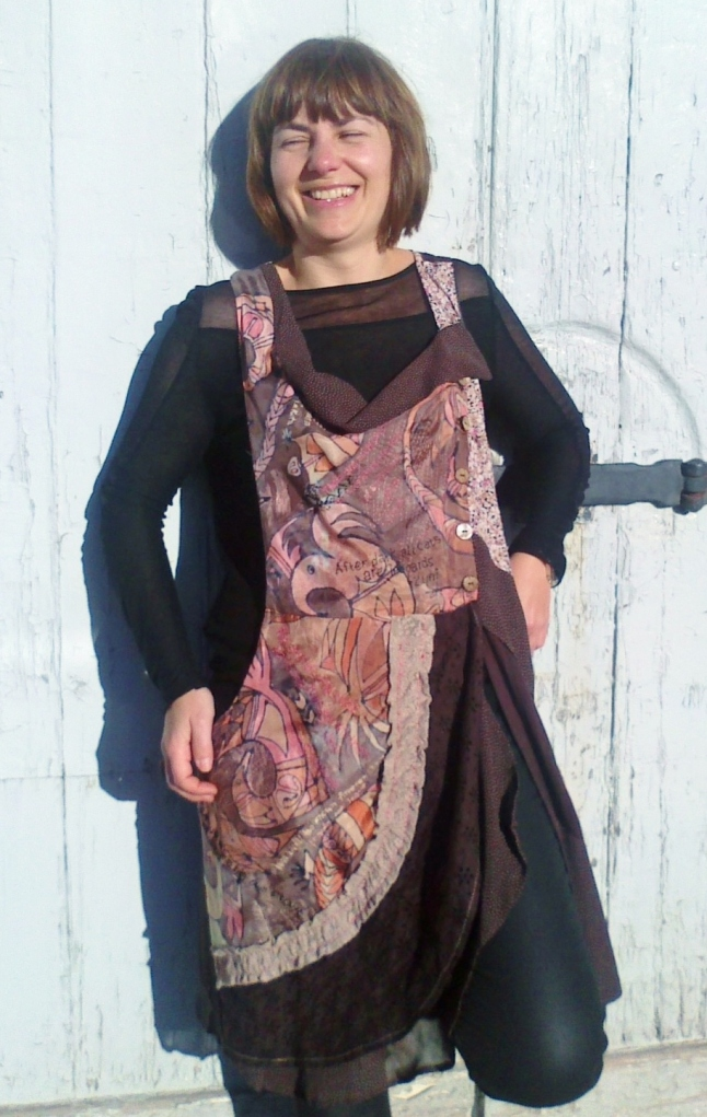 Brown pinafore dress, layers of brown cotton and viscose, with pink, orange and brown silk Hopi Bird design.