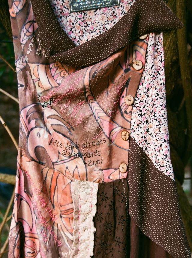 Silk painted 'Hopi Bird design' on bib and apron of Pinafore Dress.