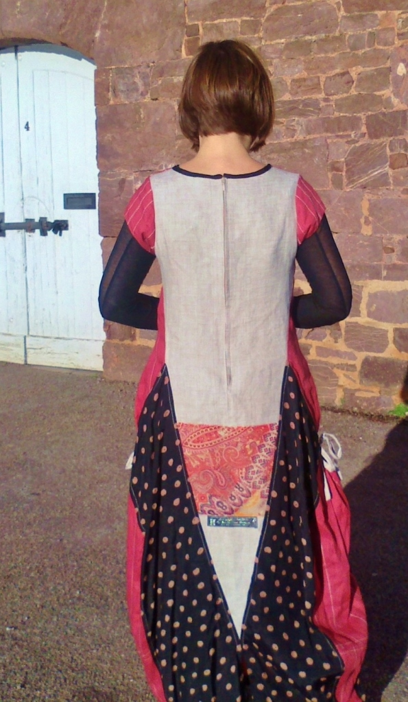 Red linen 'Hopi dance' dress, back view with cream linen and black viscose panels.