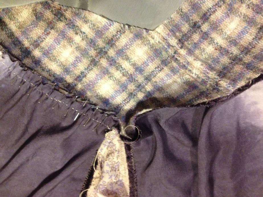 Pinning and tacking skirt front to cummerbund lower edge.JPG