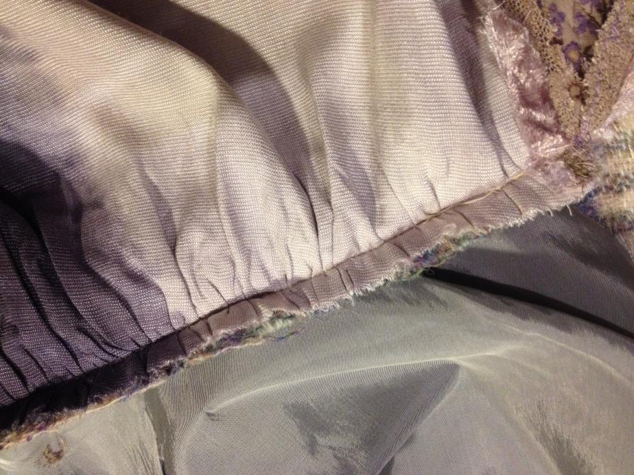 Velvet machined to wool cummerbund over tack gathered.JPG